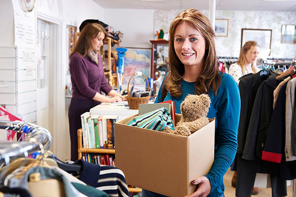 woman donating secondhand items